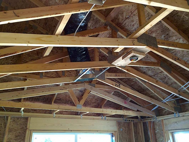 Roof to wall attachments aries inspection company for What type of wood is used for roofs